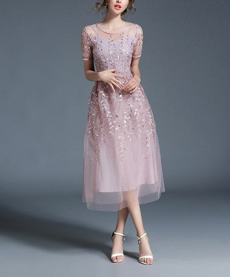 Add glamour to your wardrobe with this figure-flattering A-line dress boasting romantic embroidered detailing.