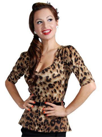 Leopard Print Beverly Top by Rock Steady. Available at Anomalie Clothing! This stunning Rock Steady top features a racy leopard print design; a jaw dropping sweetheart neckline; stylish peplum waistline; detachable patent leather belt with bow design; half length sleeves; stretch jersey fabric (80% Polyester, 16% Rayon, 4% Spandex). For that classic bombshell look, team it up with a pencil skirt and stilettos.