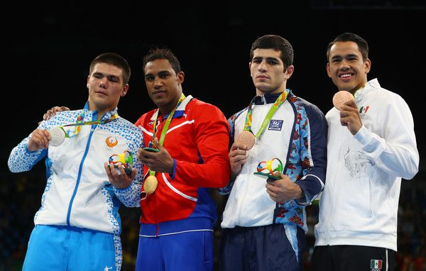 L-R) Silver medalist Bektemir Melikuziev of Uzbekistan, gold medalist Arlen Lopez of Cuba and bronze medalists. Kamran Shakhsuvarly of Azerbaijan and Misael Uziel Rodriguez of Mexico pose during the medal ceremony for the Men's Middle (75kg) on Day 15 of the Rio 2016 Olympic Games at Riocentro - Pavilion 6 on August 20, 2016 in Rio de Janeiro, Brazil.