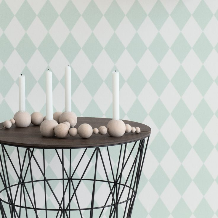Design your very own candleholder with ferm LIVING's Candleholder String. There is room for four candles, so you can even use it for Advent during Christmas time or it makes a wonderful rustic wedding reception centerpiece. Made with wooden pearls on a leather string.