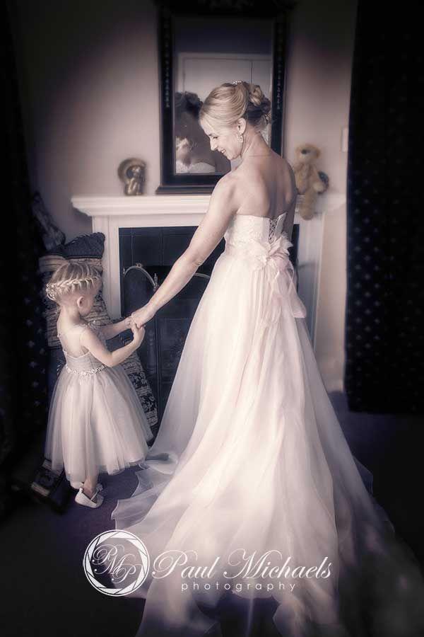 Bride and flower girl. New Zealand #wedding #photography. PaulMichaels of Wellington www.paulmichaels.co.nz