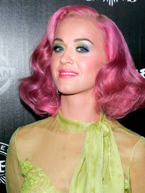 Queen of pastel hair Katy Perry goes for a bubblegum pink cartoon vibe.