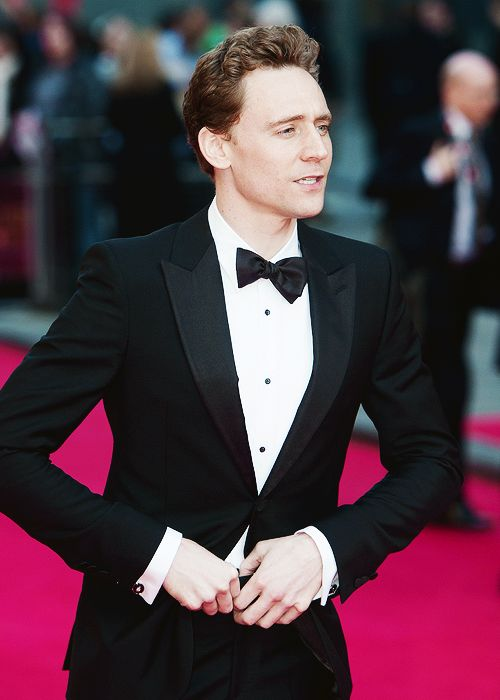 Daaaannngggg... There are men in suits...and then, there's Hiddleston in a suit