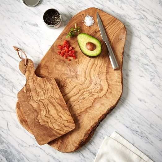 These cutting boards are crafted from solid olive wood, known for its durability and rich wood grain. Their natural edge and oil-finished wood strike the perfect balance between polished and rustic.