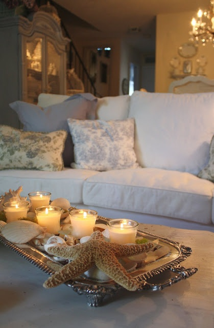 *beautiful summertime decor with candles and shells.