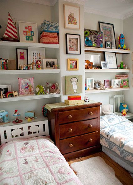 Design Solutions for Shared Kids Bedrooms...Too small for a physical divider, each child gets their own set of shelves while a chest of drawers visually divides the space.