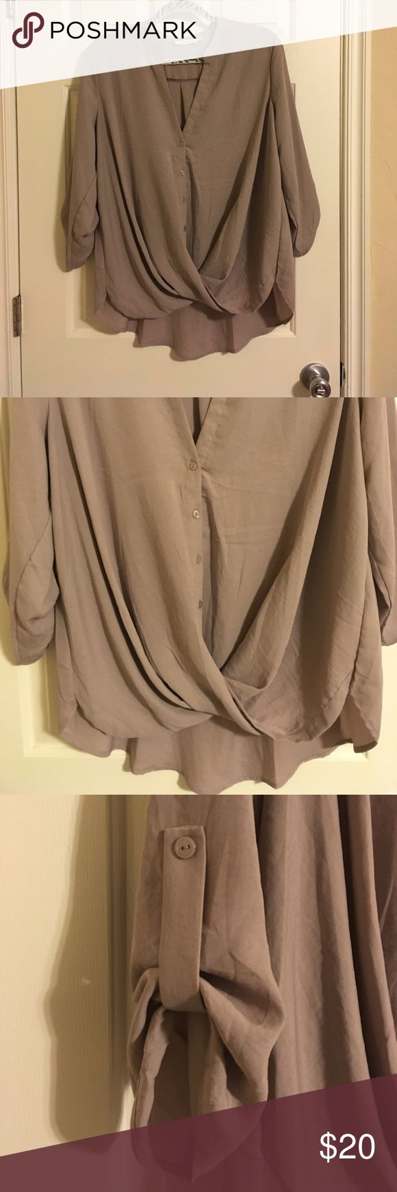 Lush Twist Front Top New with tags. Purchased from Nordstrom. LUSH soft tan (sphinx) blouse. V-neck, then buttons down, but wait! The bottom hem is a twist/loop design. Longer shirt tail in the back. About 3/4 length sleeves that fold back with a tab. This top is amazing and can be worn with anything! Pants or a skirt to work, leggings, a mini skirt, denim cut offs, jeans... Soft, lightweight material feels so good on the skin. Again, one I bought in several colors. May still be in stores…