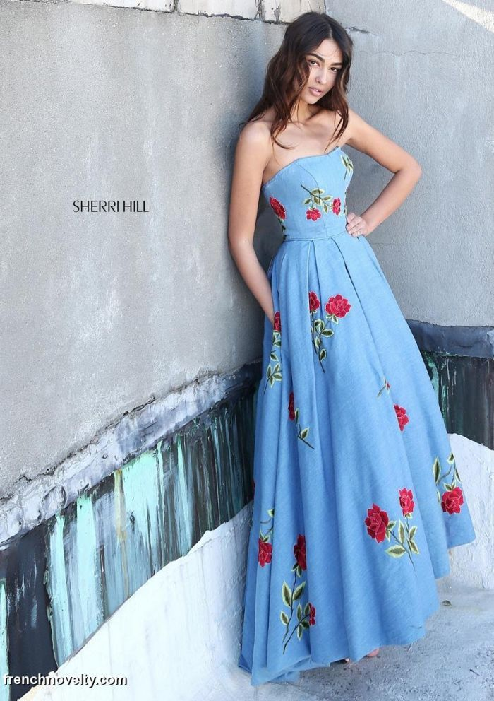 Sherri Hill 51154 is a strapless denim prom dress with embroidered floral detail and a high low hem.