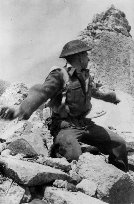 A New Zealand soldier at the battlefront in Cassino, Italy - 5 April 1944  Photo by George Kay  This is a staged photograph used for propaganda purposes. During the month of April, there was a lull in the fighting during the Battle of Monte Cassino as the third battle had come to a conclusion at the end of March and the fourth, and final, battle would not begin until early May.
