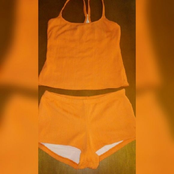 NAUTICA Orange Cream Tankini NAUTICA SEPARATES orange cream tankini Sz 10. Has been worn once. Bottoms are lined and top is racer back with built-in bra. Will be shipped freshly laundered. Nautica  Swim Bikinis