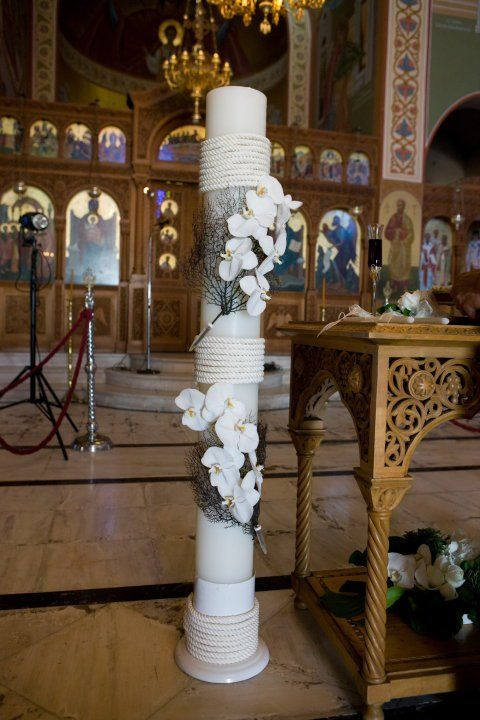 Greek Orthodox wedding in Santorini. Event design by Evangelia Mendrinou. www.StellaAndMoscha.com
