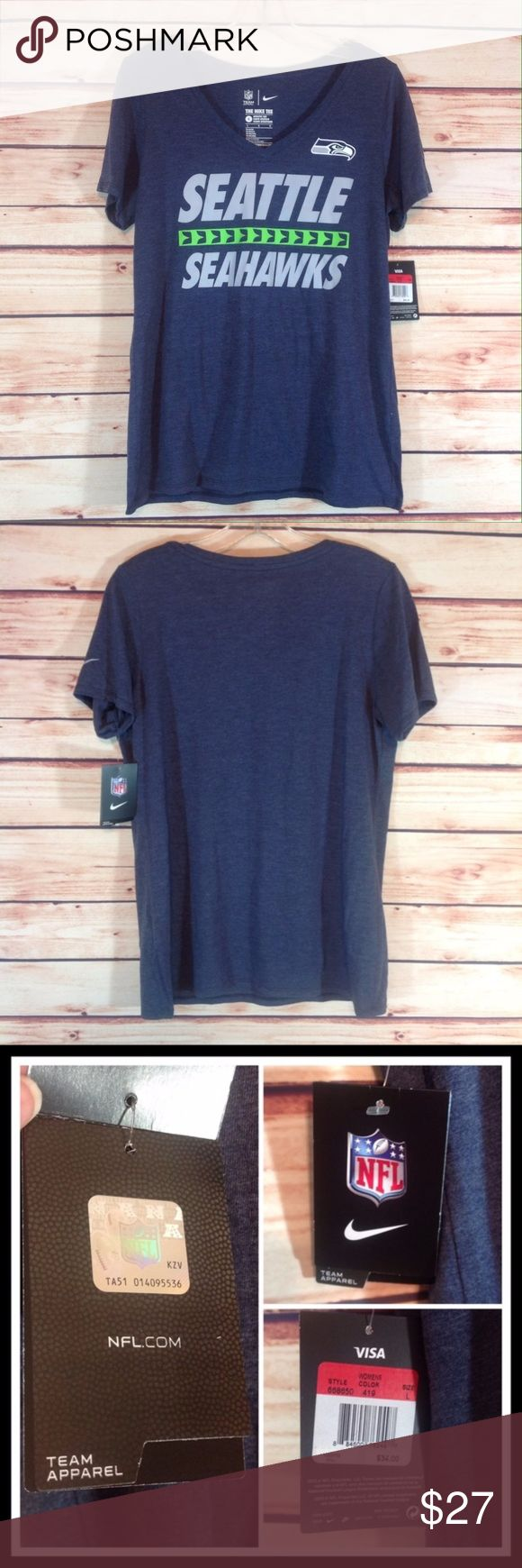 "Nike NFL Official Seattle Seahawks Tee Large NWT Brand new with tags! NWT. Nike NFL official Seattle Seahawks team T-shirt. Ladies Large. Bust 18"" across flat. 27"" long. grayish-blue with lt. gray and green team color lettering.   🔹Please ask all your questions before you purchase! 🔹Sorry, no trades or holds 🔹Bundle for your best prices! Nike Tops Tees - Short Sleeve"
