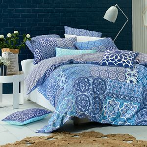 A highly decorative mosaic pattern in rich, deep blues and bright sea blue provides Ascot with an exotic, Mediterranean feel. Hints of aqua, mint and white deliver fresh accents to create a design for all seasons. The quilt cover has a blue and white patterned reverse and press stud closure.