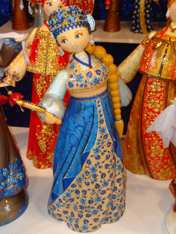 A painted wooden doll is one of the traditional Russian toys. (beads for hair…