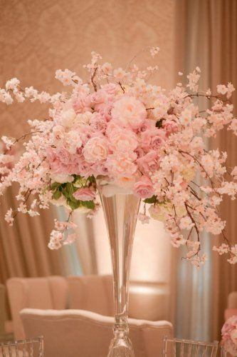 dreamy pink and white floral wedding reception centerpiece