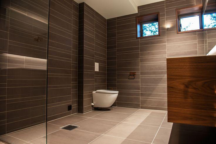 Singelfamily house  Built: 2016 Architect: Marita Hamre Furniture: Panta Rei walnut, Antonio Lupi Tiles: Beige & Brown, Mosa tiles