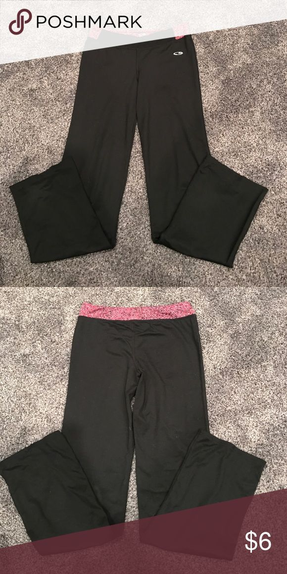 Youth girls champion yoga pants Black yoga pants with pink and grey speckled band, great condition Champion Bottoms