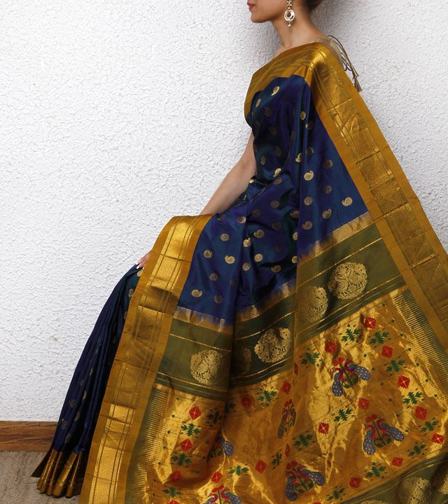 Teal Blue Paithani Silk Saree. These traditional sarees may or may not appeal to some vibrant spiritual souls who seek to be different from the herd. What they can do is pick an unusual color that's rarely seen. Then try and team it with an offbeat blouse.