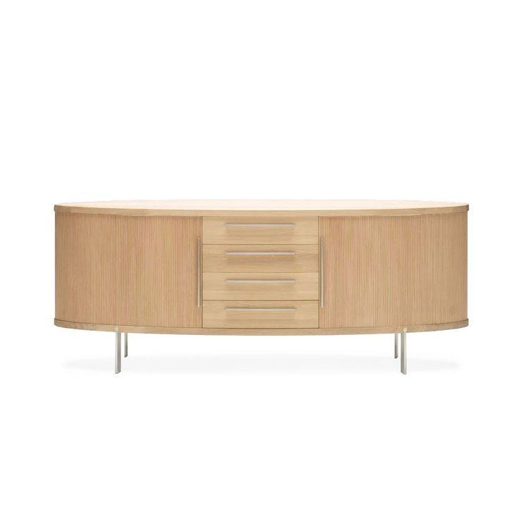 AK 1300 sideboard från Naver är formgiven av Nissen och Gehl och tillhör en modern serie bestående av ovala skänkar och skåp i trä och rostfritt stål. Fungerar perfekt fristående, som rumsavdelare eller längs väggen. AK 1300 har både jalousier och lådor och finns i flera olika träslag.