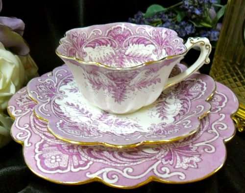 Wileman & Co./Foley (pre-Shelley) tea cup, saucer, and small plate, in mauve Fern pattern with gilt edges and handle, in Empire shape.  Made in England ca 1893.