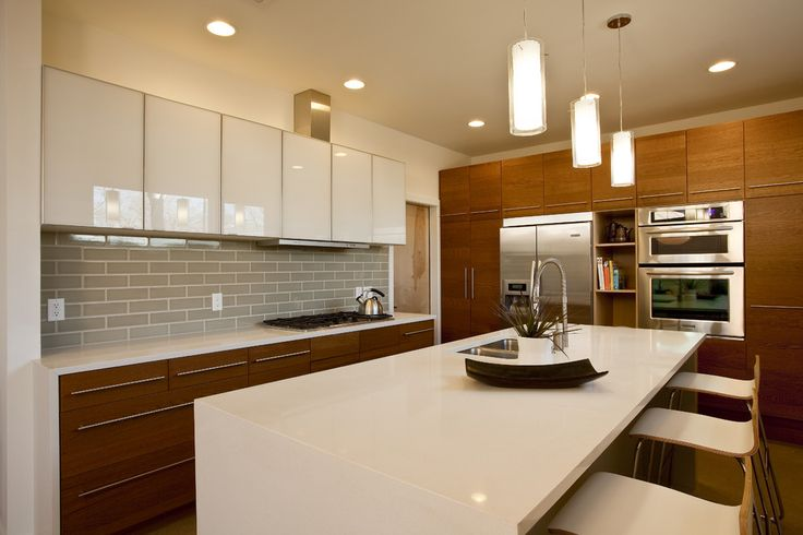 Glossy white combined with wood cabinetry enhance this modern kitchen  - Trend Alert - Mixed Cabinet Finishes in the Kitchen