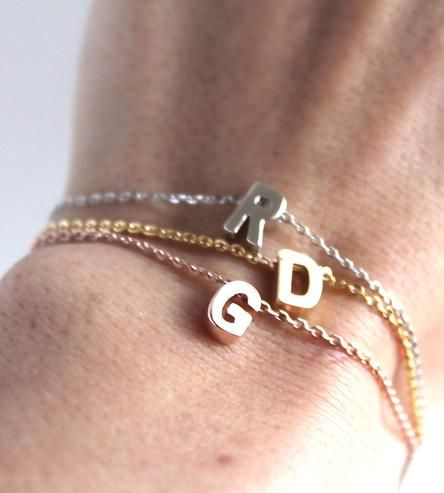 Wear this custom bracelet to show your affiliation with and affection for a particular letter. And, if you're feeling verbose, pair a few of 'em together to spell out a secret message. Each letter dangles freely from the bracelet chain.