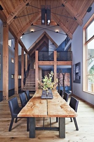 Contemporary Dining Room with Natural farm table, Exposed beam, Reclaimed Wood Beams, Hardwood floors, Columns