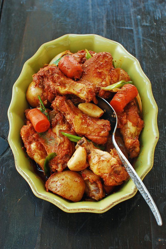 DAKDORITANG (KOREAN SPICY CHICKEN STEW)    ==Ingredients== 3 lb bone-in chicken, 10 oz potatoes cut into big chunks 2 carrots cut into big chunks 1/2 large onion cut into big chunks 4 - 5 plump garlic cloves 2 - 3 thinly sliced ginger pieces 2 scallions cut into 2-inch lengths =SAUCE= 2 T Korean red chili pepper flakes (gochugaru) 1 T sugar 4 T soy sauce 2 T rice wine 1 T honey or corn syrup 2 T Korean red chili pepper paste (gochujang) pinch pepper 1 T sesame oil 1 t sesame seeds  ====