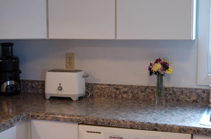 Faux painted granite counter top!  Around 30 dollars...done with a kilz primer, small bottles of acrylic paint, paper towels, and a high gloss clear top coat.