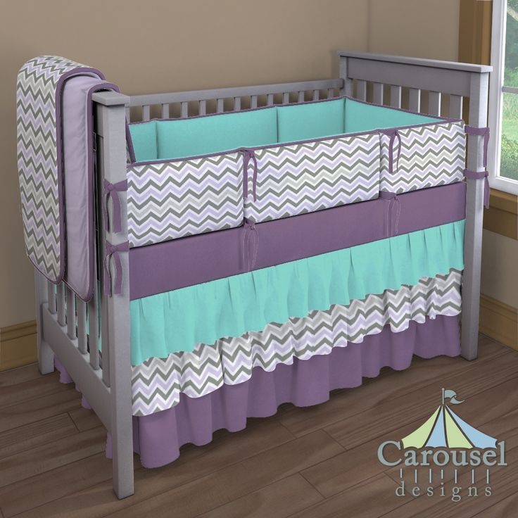 Crib bedding in Solid Aubergine Purple, Solid Teal, Lilac and Slate Gray Chevron, Solid Lilac Minky. Created using the Nursery Designer® by Carousel Designs where you mix and match from hundreds of fabrics to create your own unique baby bedding. #carouseldesigns trendy family must haves for the entire family ready to ship! Free shipping over $50. Top brands and stylish products