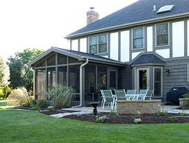 Year round sunroom additions affordable custom room for Affordable home additions