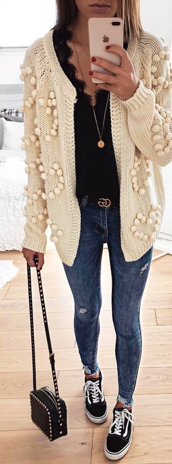 #spring #outfits  woman wearing white cardigan and blue jeans and holding black leather crossbody bag. Pic by @fashionpuglady