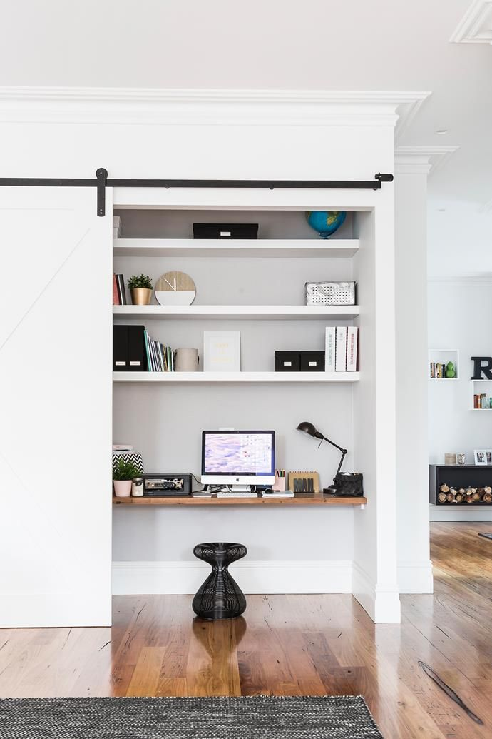 This Study Nook Is Cleverly Concealed Behind A Sliding Door Within Living Room Photo