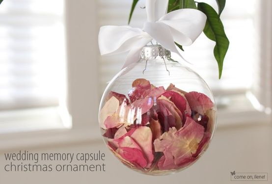Collect your flowers from the wedding and place them in a clear Christmas ornament for your Christmas Tree