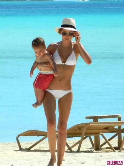 Miranda Kerr shows off her beach body in a white bikini while vacationing in Bora Bora with son Flynn