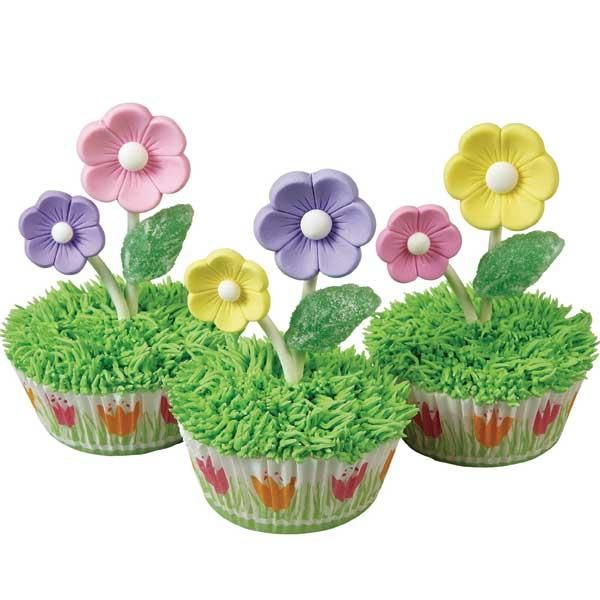 Blooming Cupcakes - Top your cupcakes with 3-D flair! Make your flowers ahead of time using royal icing and decorating tips or melted candy and candy  molds. Attach your blooms to Lollipop Sticks for treats that really stand out.