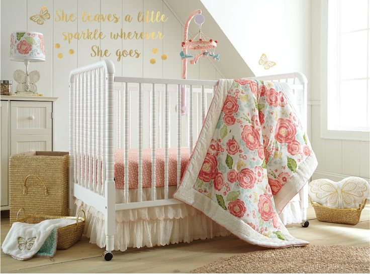 The Charlotte Nursery Collection features a beautiful vintage inspired floral pattern in cream, coral and aqua with metallic gold accents. The cotton voile tiered dust ruffle is the perfect mix of feminine glamour with a scallop embroidered edge and touch of metallic sparkle throughout. The 5 Piece Crib Bedding Set includes a Quilt, 100% Cotton Coral Dot Crib Fitted Sheet, 100% Cotton Gold Dot Crib Fitted Sheet, Dust Ruffle and metallic gold Wall Decals.