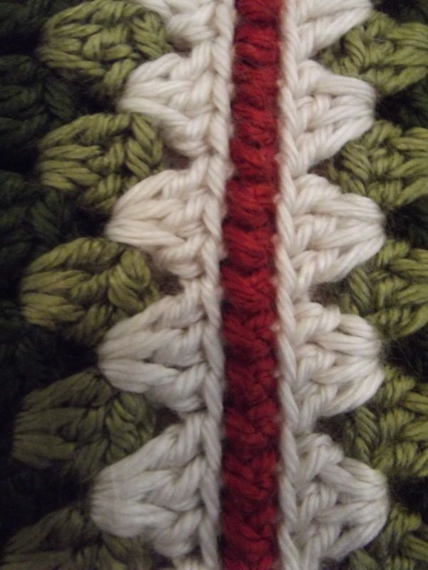 oooh, this looks a nice way to join squares maybe? - reverse single crochet (or crab stitch) but the trick is to use only the back loop (put wrong sides together) and catch only the back loop on the square facing you and the first loop and the square facing away.