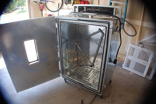 "Flickr user j_tenkely wanted to do his own powder coating, so he bought a commercial powder-gun and built a custom oven in his garage. He says, ""the entire oven cost about $250, but when it runs about $150 to do a bike frame & fork, it's easy to break-even."""