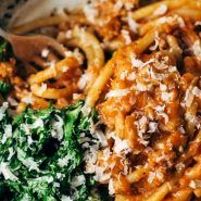 Creamy Pumpkin Spaghetti with Garlic Kale - this is the most crazy good combination! Spicy turkey, creamy pumpkin sauce, and pasta!