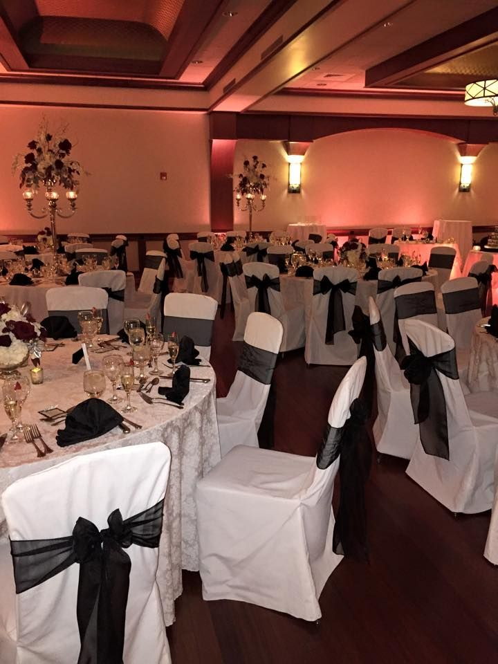 Our White Chair Covers With An Added Black Bow Very Simple Wedding Look Here Interested In Having Your At The Cafe Escadrille Call Today And Book