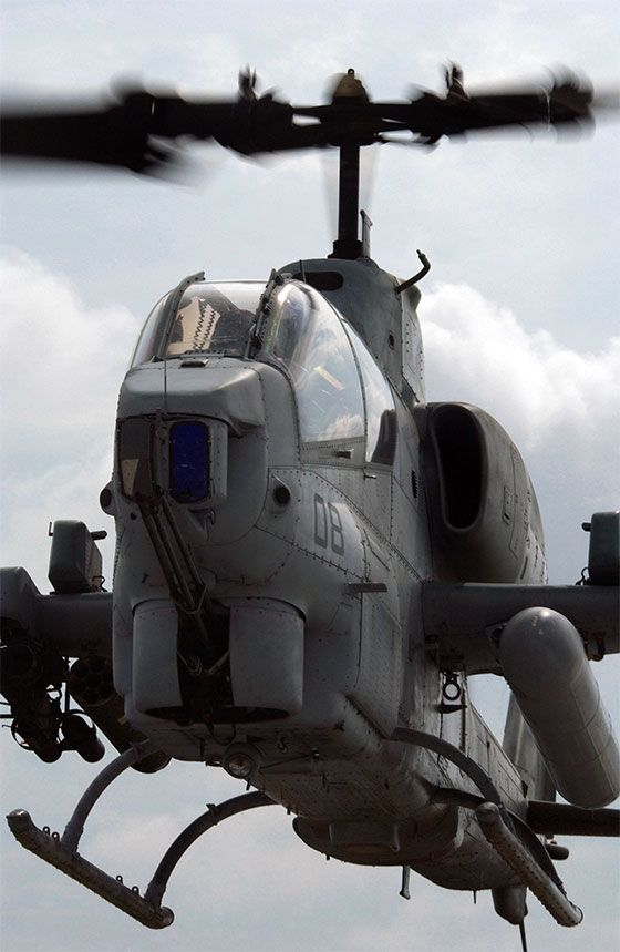Closeup of a AH-1W Super Cobra in a hover. Note the fuel tank on the left-hand pylon. Photo taken at : Hurlburt Field, Florida, USA DoD photo by: AMN ANDY M. KIN, USAF