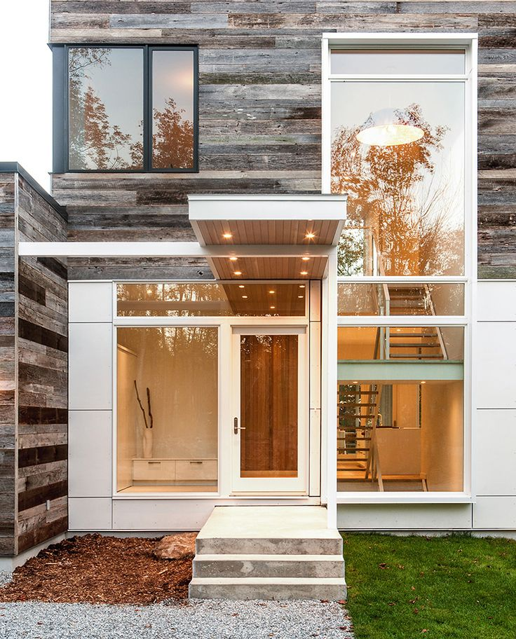 Modern exterior of home with marvin ultimate casement window exterior stone floors pathway