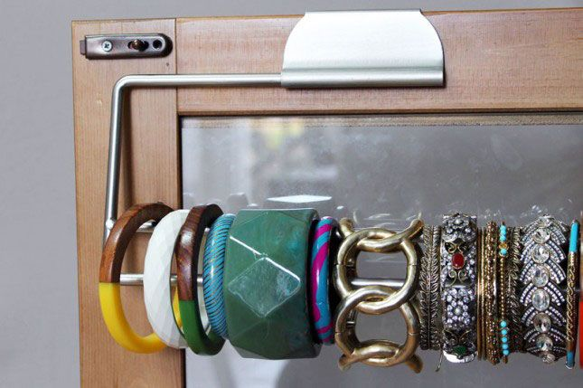 Genius! Store bangles on a paper towel holder to stay organized.