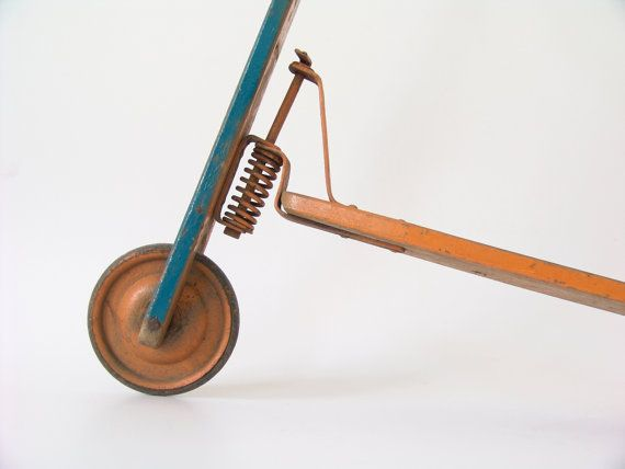 Antique children's scooter made of wood and metal blue &