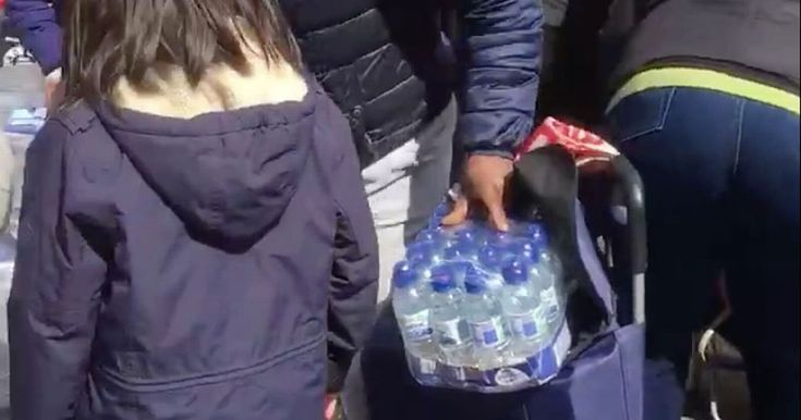 Dozens of people were seen swarming around a water station as they loaded litres of Buxton water into trolleys while runners still went past behaving like tories disgraceful.
