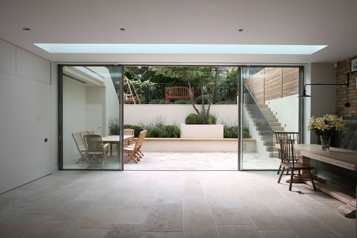 minimal windows to lower ground floor in London with walk on roof light above