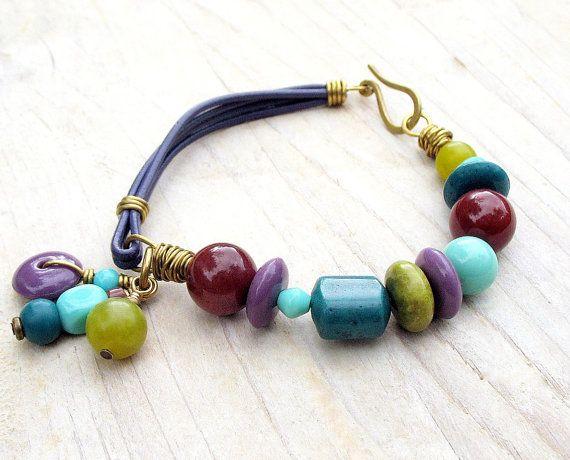 Beaded Leather Bracelet Rhapsody Purple Chartreuse Teal Turquoise Plum Burgundy Geometric Beads Charms. $45.00, via Etsy.