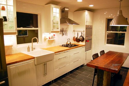 Love this kitchen redo, would be great for galley style kitchens common in older homes.