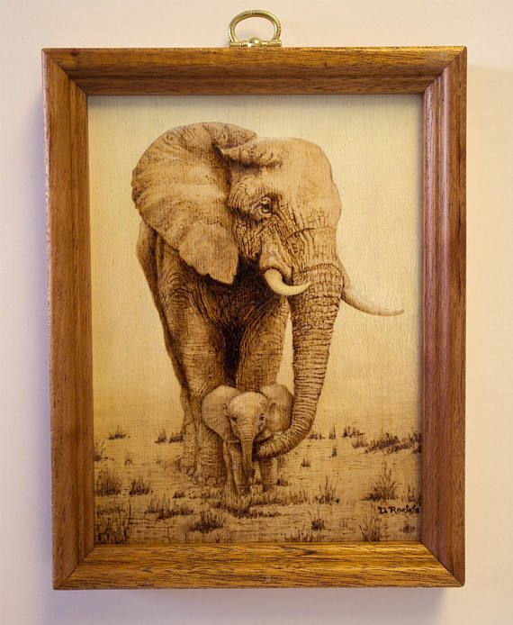 From the Savanna's of Africa, a mother elephant protects her new-born baby. This is a pyrography piece, burned onto thin plywood, and framed in mahogany. #ad